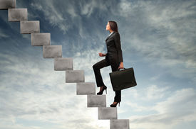 image of step-up  - Businesswoman stepping up a stairway with sky in the background - JPG