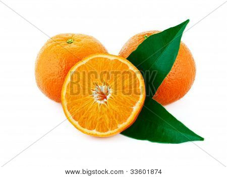 Two Whole And One Sliced Mandarin