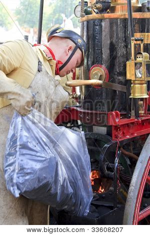 Man Stoking Coal Old Steam Locomotive