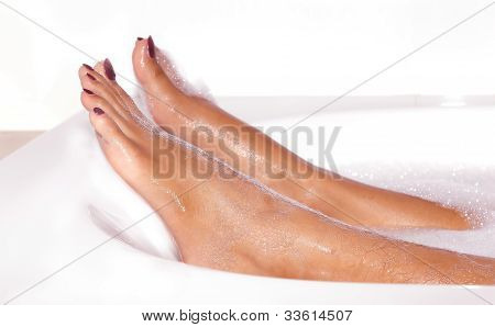 Young Lady Leg In Bath