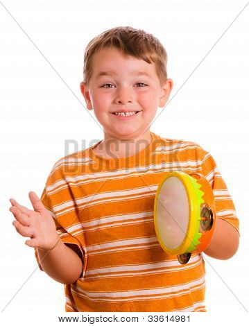 Happy smiling child playing tambourine isolated on white