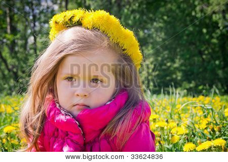 Little girl with floral wreath on her head