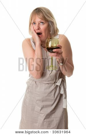 Woman with Shocked Expression Holding Wine Glass