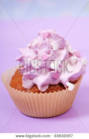 pink cupcake with white and pink hearts