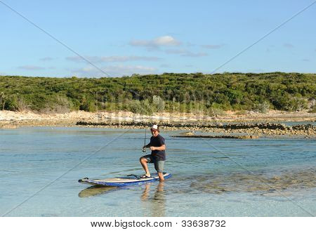 Man On Paddle Board Fishing