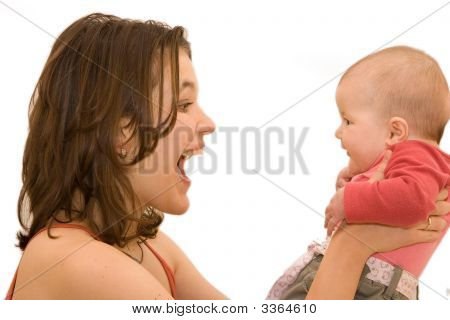 Beautiful Young Mother With Her Precious Baby Girl