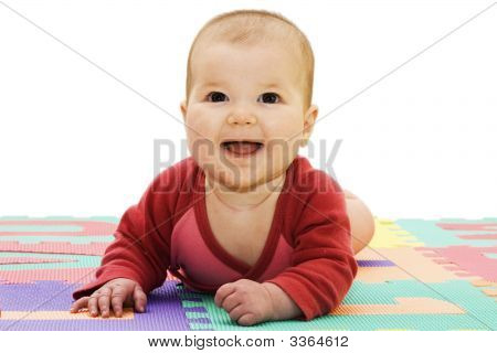 Nice Looking Baby Girl Smiling On A White Background