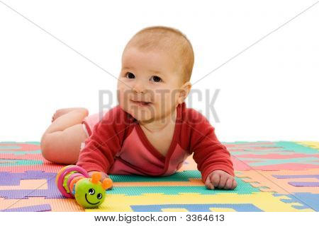 Nice Looking Baby Girl Smiling In A White Background