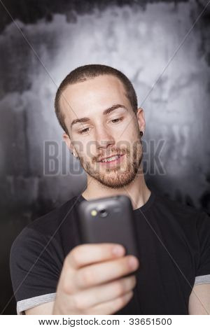 Man Typing Sms On Cell Phone
