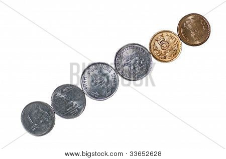 Closeup Indian currency Coins row diagonally placed isolated on white copy space