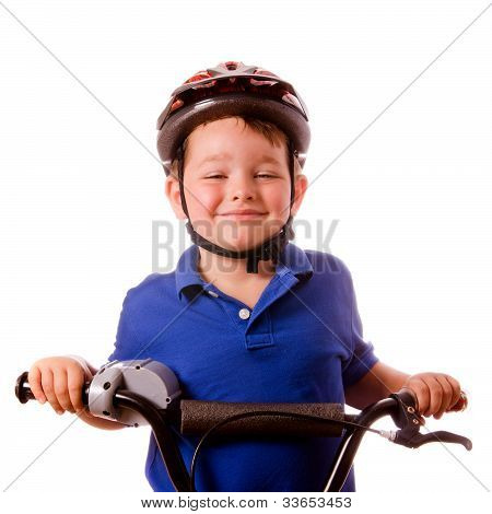 Happy child riding his bike isolated on white