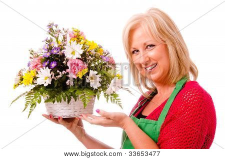 Portrait of smiling happy florist with flower arrangement isolated on white