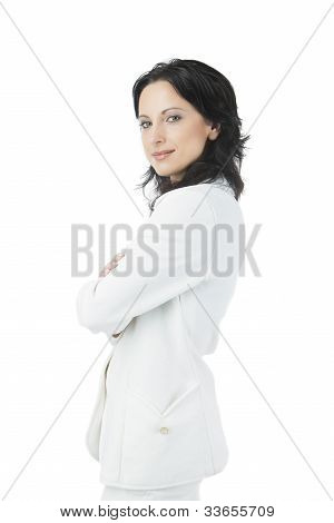Portrait Of A Seriously Looking Businesswoman Smiling