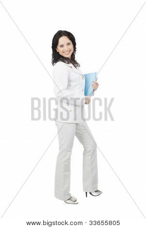 Full Length Portrait Of A Young Happy Caucasian Businesswoman Holding File