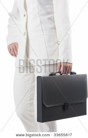 Fragment Shot Of A Caucasian Woman In White Suite And Briefcase