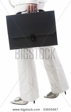 Legs Of A Business Woman Holding Briefcase