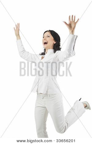 Full Length Portrait Of A Woman Rejoicing And Making A Jump