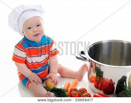 Junge mit einer Pfanne