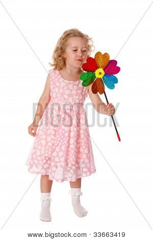 Little girl blowing on the windmill