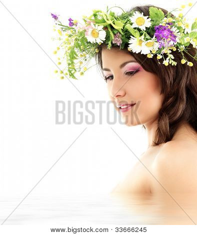 beauty summer portrait of young beautiful woman with garland of field fresh natural wild flowers isolated on white background