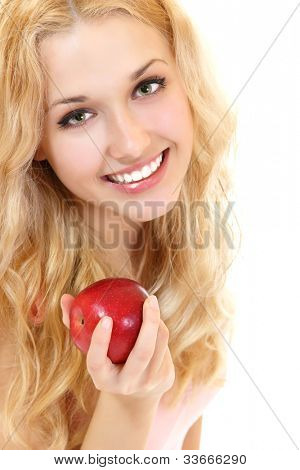 Young happy healthy woman with fresh ripe red apple, isolated on white background