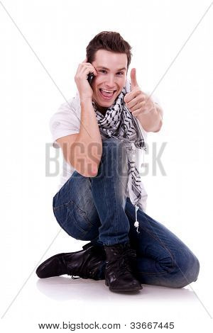picture of a young fashion man pointing to the camera on white background