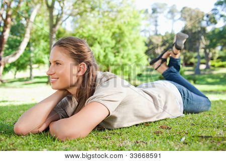 Young woman taking a moment off in the park