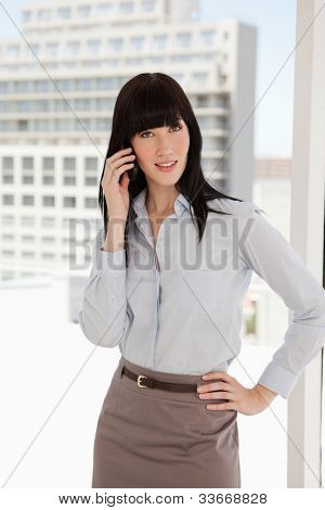 A business woman at work taking a phone call