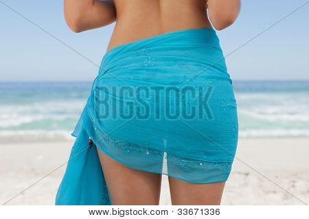 Rear view of a young woman wearing a sarong wrapped around her waist