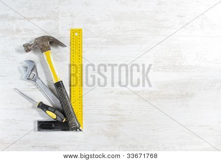 Tools Set For Construction Work Over Wooden Background.