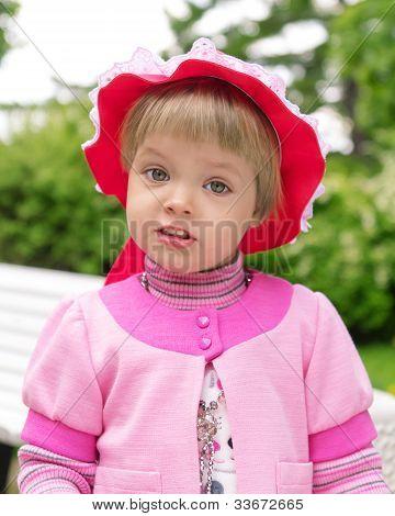 Cute Little Girl In A Park Close Up