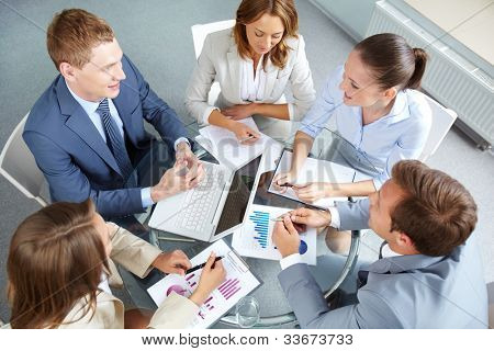 Image of large group of confident partners planning work at meeting