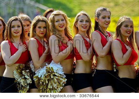 VIENNA, AUSTRIA - JUNE 5 Cheerleaders during the national anthem at Charity Bowl XIII on June 5, 2011 in Vienna, Austria. Rose Hulman College beats Team Austria 35:34 in overtime.