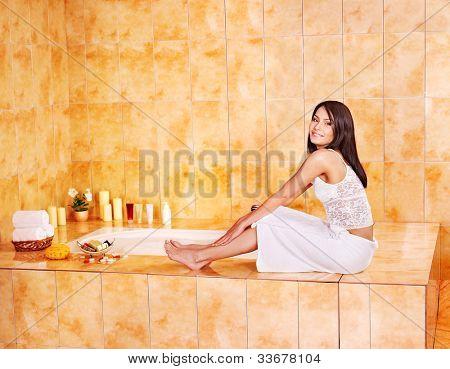 Woman in bathroom take bubble  bath.