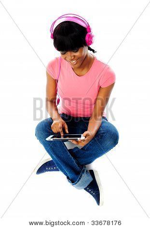 Lovely Girl Listening Music In Headphones