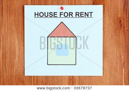 Poster über das Haus auf hölzernen Hintergrund mieten