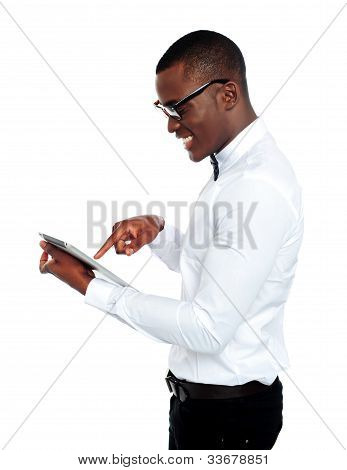 Young African Geek Using Electronic Device