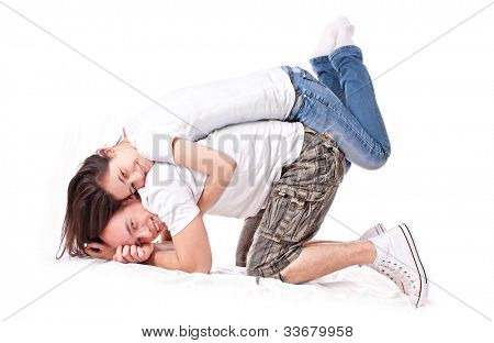 Happy couple posing over white background