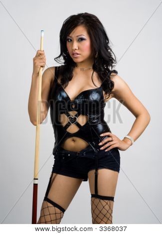 Asian Girl In Sexy Outfit Holding A Pool Cue