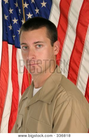 Guy In Front Of Flag