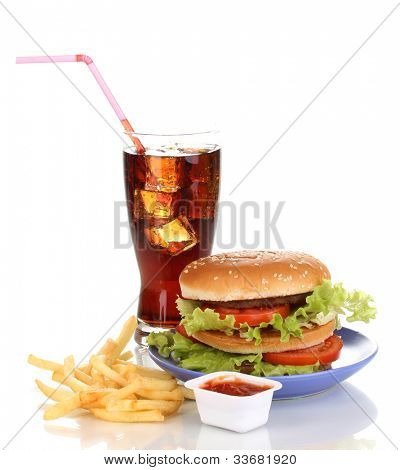 Big and tasty hamburger on plate with cola and fried potatoes isolated on white