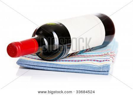 Bottle of red wine on the kitchen towel