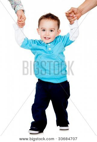 Little boy learning how to walk - isolated over a white background