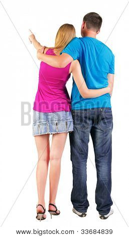 Back view of young couple pointing at wall (woman and man).  looking into the distance. Rear view people collection.   backside view of person.  Isolated over white background.