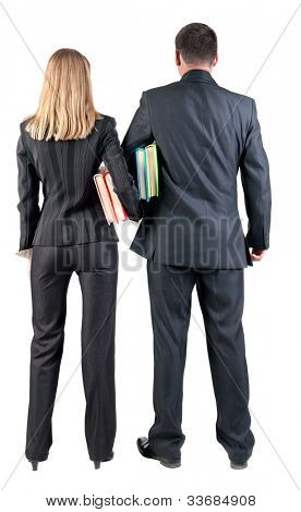 Back view of  business team look into the distance. young couple (man and woman) with books.  Rear view people collection.  backside view of person.  Isolated over white background.