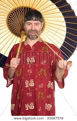 Europeans in traditional Chinese shirt holding pipe. Umbrella is made of bamboo and paper.