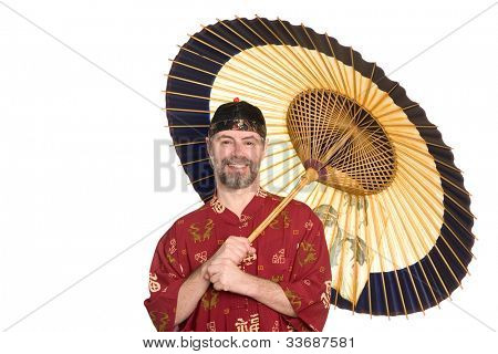 European in traditional Chinese shirt holding an umbrella. Umbrella is made of bamboo and paper.