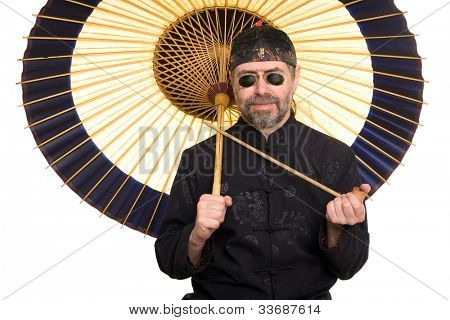 European in traditional Chinese shirt holding pipe. Umbrella is made of bamboo and paper.