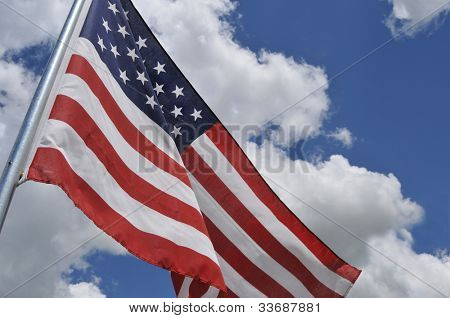 A real photo of the American flag tilted, revealing more of the sky