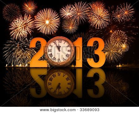 2013 year with fireworks and clock displaying 5 minutes before midnight